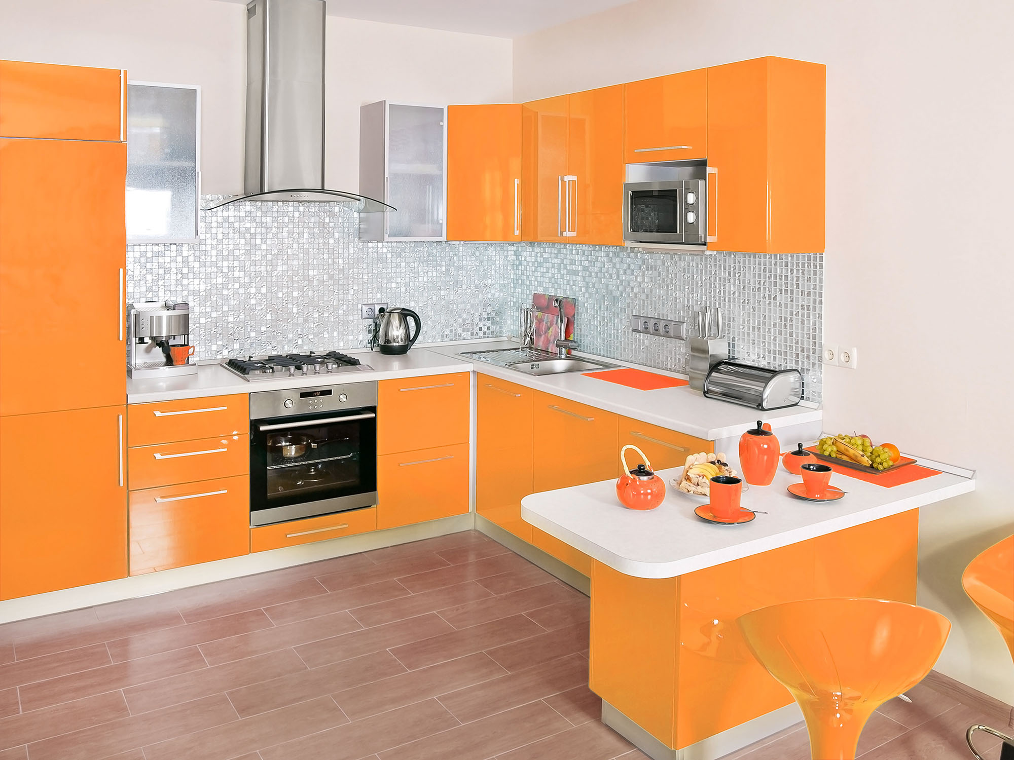 Modern kitchen interior with orange decoration