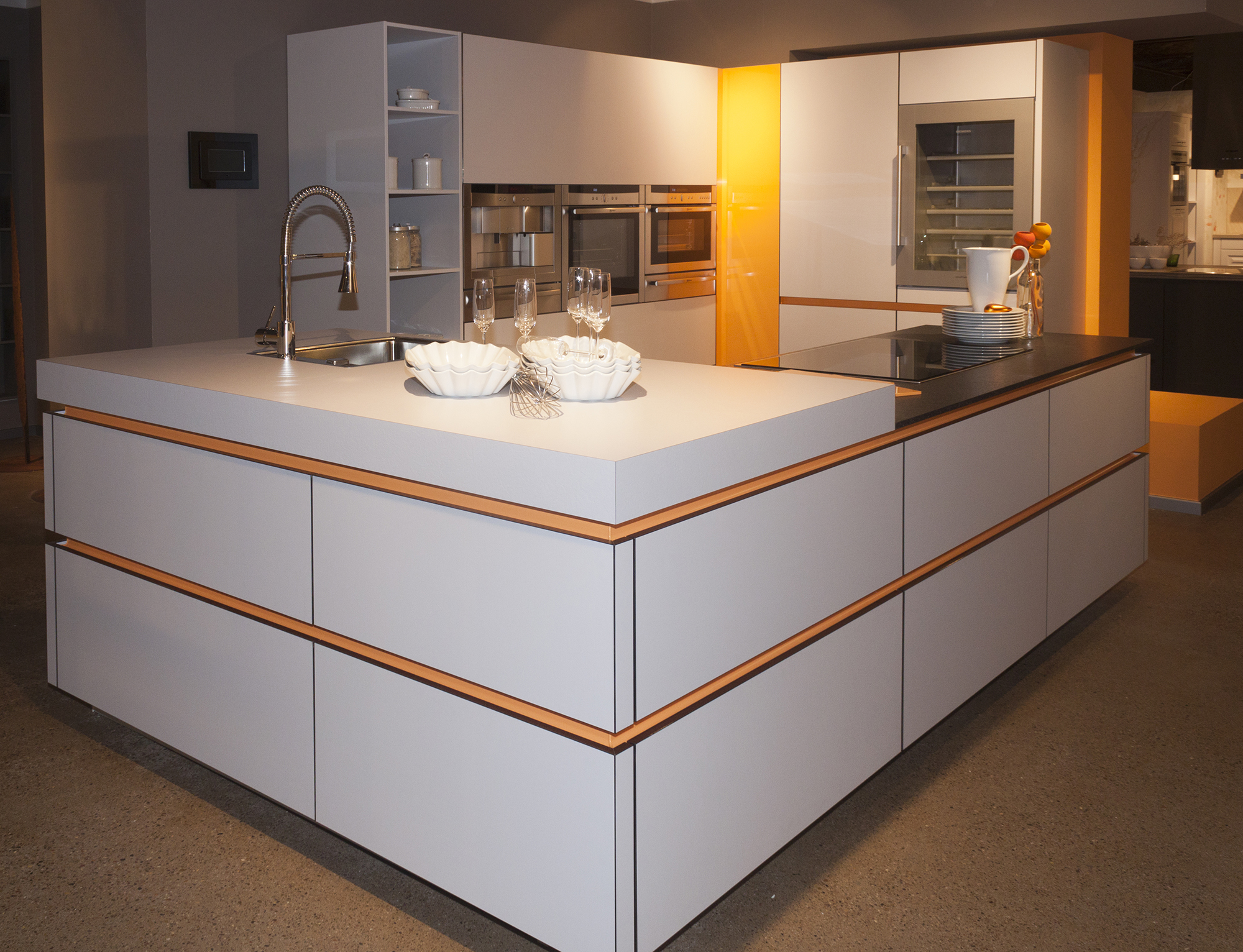White gloss and orange modern kitchen with island bar